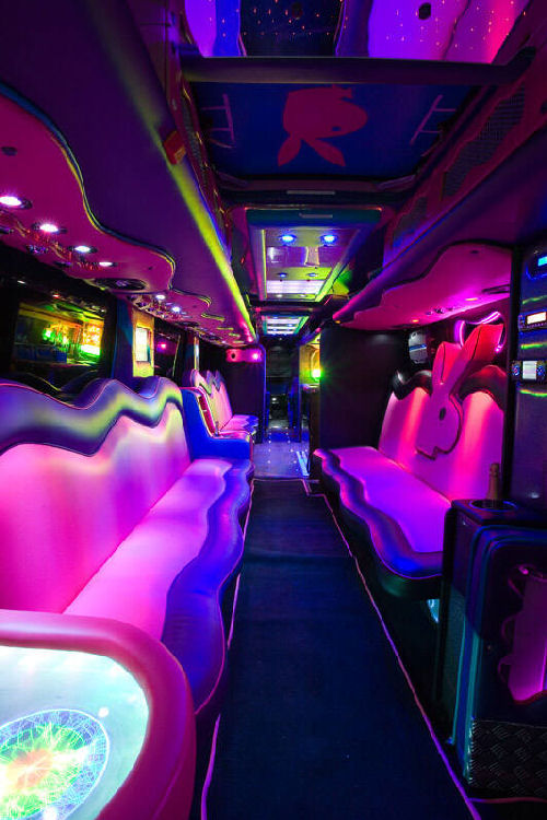 Chauffeur driven Party Bus limousine hire Play Boy den interior in Bristol, Gloucester, Cheltenham, Cardiff, Wales, Weston Super Mare, and Bath.