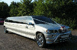 Chauffeur stretch silver BMW X5 limo hire in Birmingham, Dudley, Wolverhampton, Walsall, Midlands.