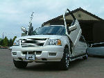 Chauffeur stretch white Ford Excursion 4x4 limousine hire with Lamborghini doors in Sheffield, Rotherham, Barnsley, Doncaster, Huddersfield, South Yorkshire
