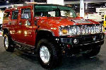 Chauffeur driven burnt orange Baby Hummer H2 hire in Manchester, Liverpool, Bolton, Warrington, North West