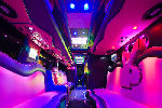 Chauffeur driven Party Bus limo hire Play Boy den interior in Bristol, Gloucester, Cheltenham, Cardiff, Wales, Weston Super Mare, and Bath.