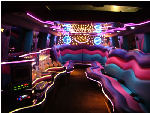 Chauffeur stretch pink Hummer H2 limousine hire interior in Bristol, Gloucester, Cheltenham, Cardiff, Wales, Weston Super Mare, and Bath.